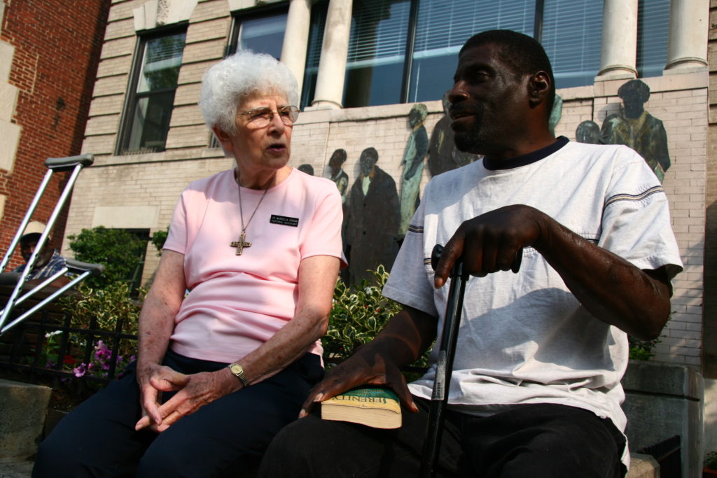 Sr. Marcella pictured with a Christ House patient in 2009