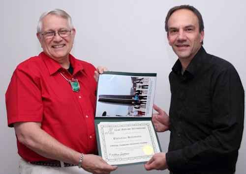 Chris Hohmann receives his certificate from Bill Dettmer