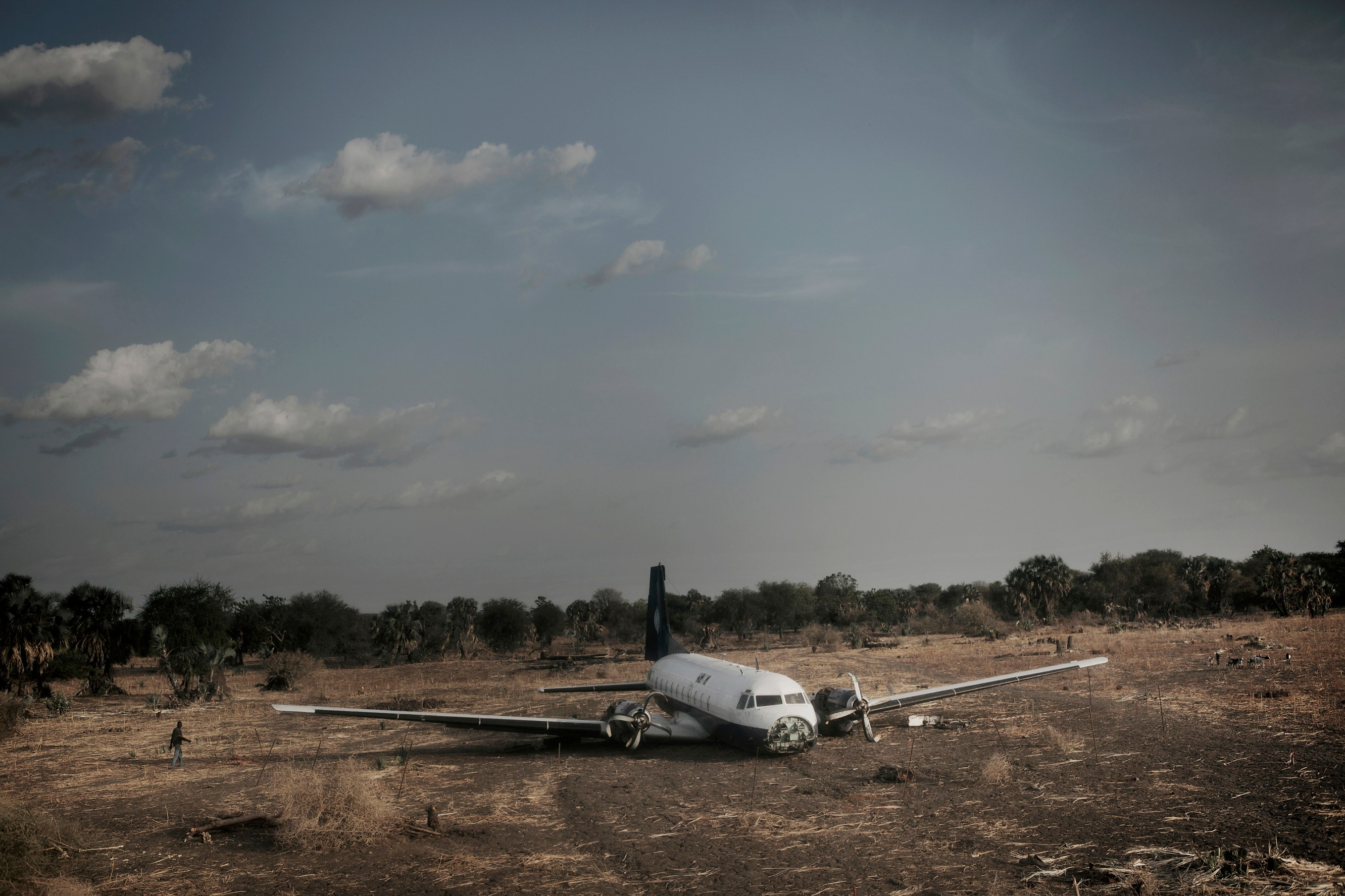 A stricken aeroplane lies, where it crash-landed, at the end of the Maban airstrip.