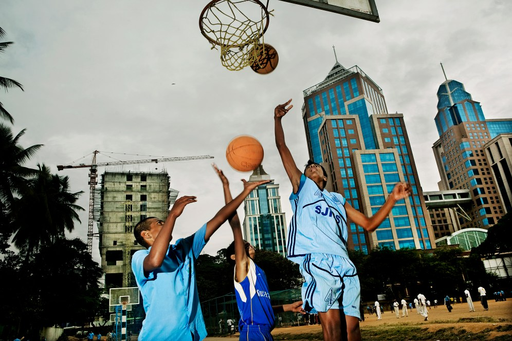 School boys are playing basket in front of the newly build UB City in Bangalore.