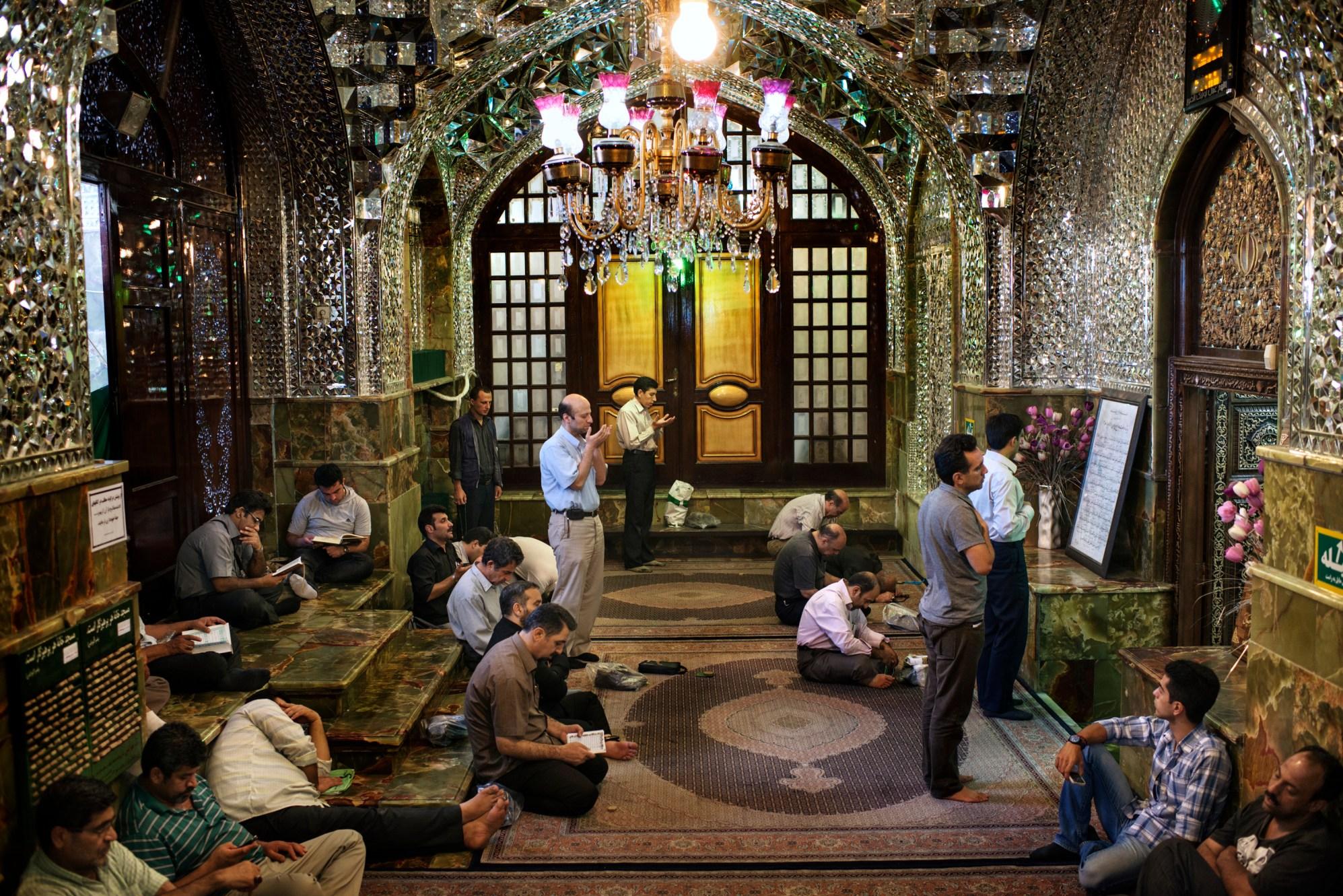 Prayers in the Imamzadeh Saleh mosque in Tajrish, Tehran.
