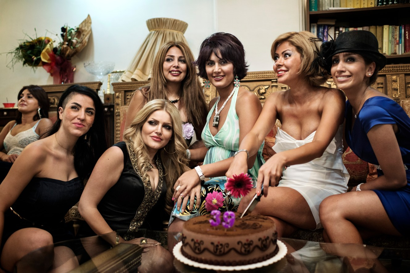 Sepideh Kaveh and her friends poses at her birthday party. It's at these high-end parties behind closed doors of fancy apartments in North Tehran, that the modern Iranians reveal another side of themselves.