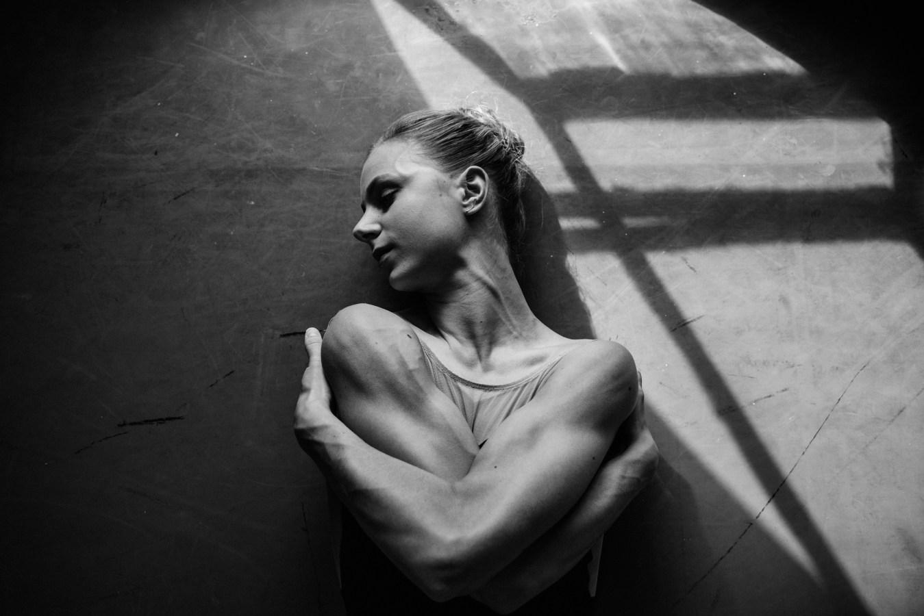 Rising star and solo dancer Ida Praetorius stretches after a training session.