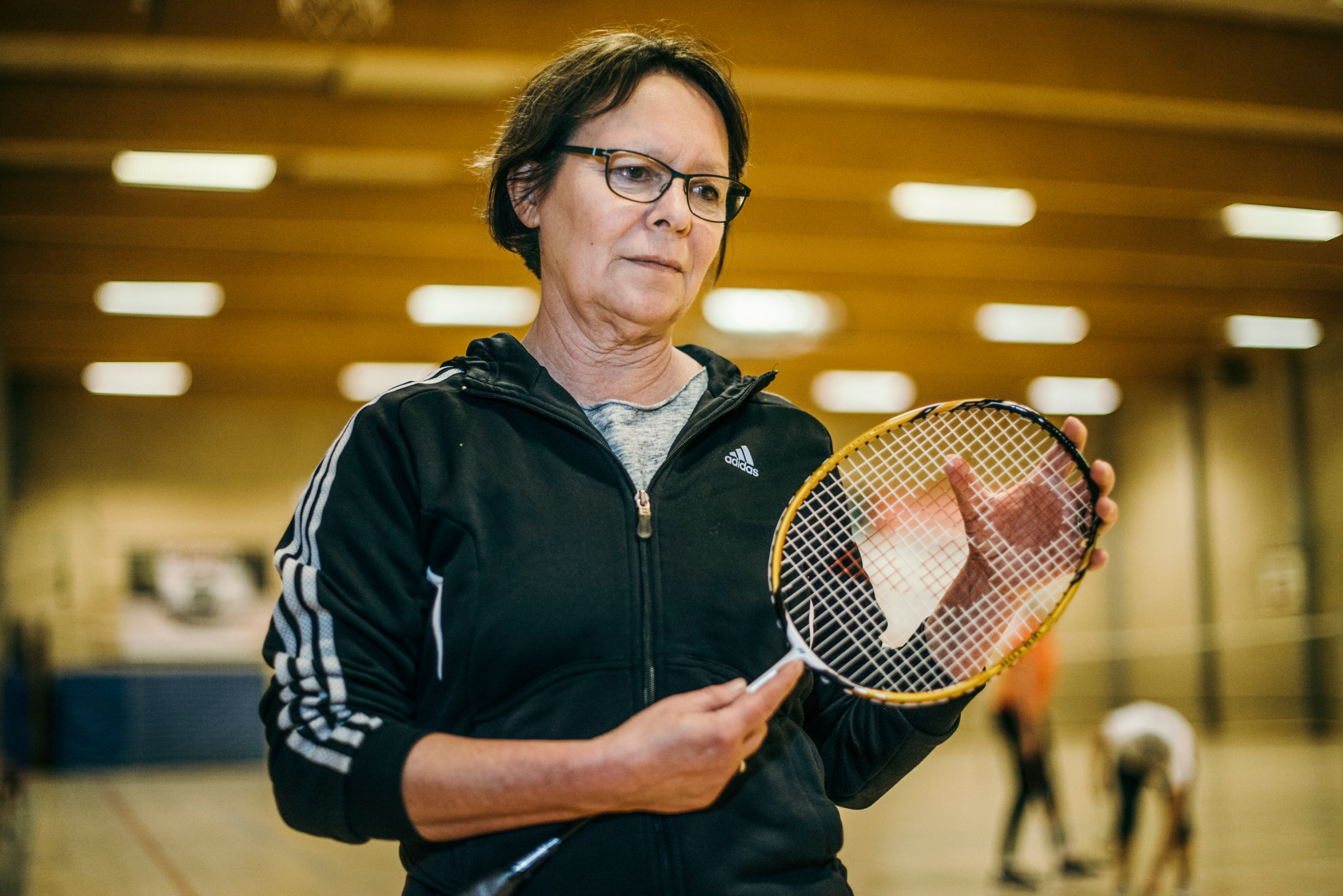 "I always have a resuscitation mask on my key ring. Inge Hjorth-Westh, 58, a teacher. It's Wednesday night, and Inge plays badminton in Rantzausminde Sports Center, as she has done every Wednesday for ten years. On the neighbouring court a senior team begin a tournament when an elderly man suddenly collapses. ""We were three who rushed over to the man. He had had a sudden cardiac arrest. Someone shouted that there was an AED in the lobby. Everybody went there and left the man alone. So I rushed back to him and took the lead. I had no idea that I had it in me. In the beginning we fumbled with the AED. None of us had tried it before. We were nervous about whether we put the pads on wrong. But it worked, and the AED started talking to me. It made it easier until I had to blow. The man who had fallen was foaming at the mouth. It was disgusting. But I overcame my reservations and went to work. It is still hard to think about. Now I know that there is a small resuscitation mask in the AED, but I didn't see it. Today I always carry one in my key ring. We took turns in giving heart massage and gave shock with the AED a few times. The man began to rattle. When the paramedics took over, I ran to the bathroom and washed my mouth with soap. Not very heroic, but it was my immediate physical reaction to the shock. And then I thought: ""Now I will sign up for an AED course."""