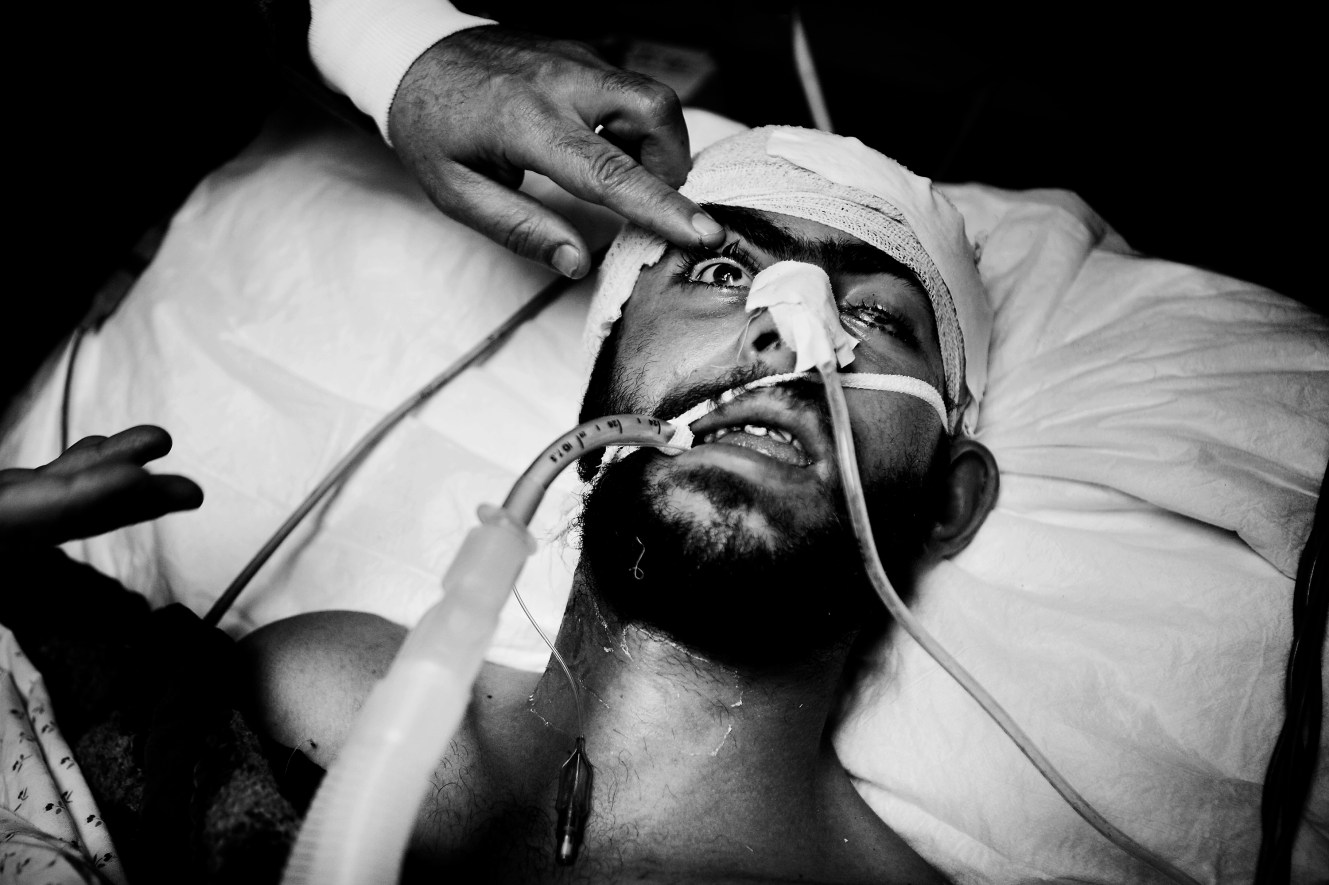 Mohammed Derba will not get older than 21 years. The young Gaza fisherman lies braindead at Shifa hospital in Gaza City. His beard is neat and his chest raises and lowers itself as the respirator ensures that his lungs and heart function. But in a few days he will get infections. He will get pneumonia, and his heart rate will decrease and become erratic. And then he will die a natural death. Alone. Without a single family member by his side.