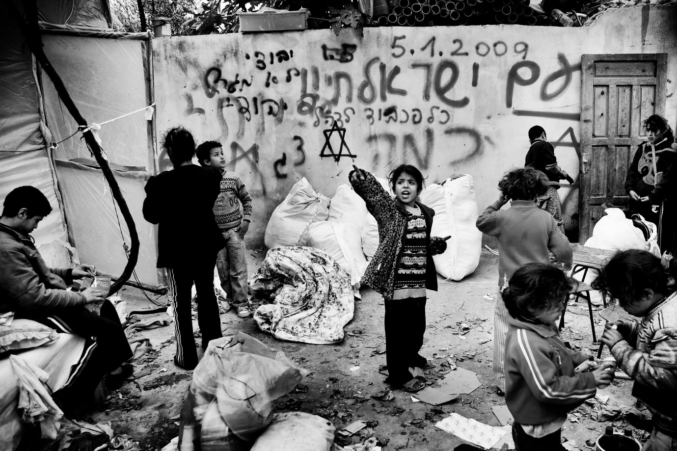 A house in Beit Lahiya is completely destroyed by Israeli soldiers. Refrigerators, computers and water tanks are shot to pieces, money and jewelry is stolen and the walls are painted with Hebrew graffiti and large Stars of David. The children immediately started to look for their toys.