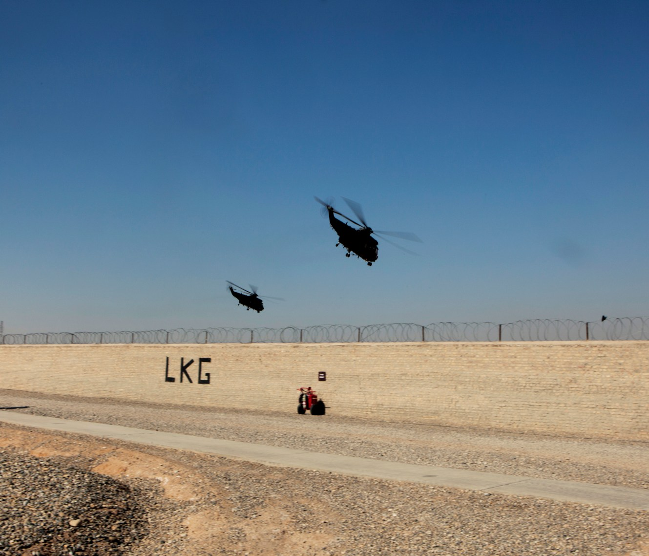 Two military helicopters fly out of the British Army base in Lashkar Gar heading to Camp Bastion. In June 2011, President Obama announced his plan to begin the withdrawal of US troops from Afghanistan, but there is currently no end date for the war in the troubled country. Helmand is the largest province in Afghanistan, and the heart of the war against terror. Commanders on the ground have described the situation as the most brutal conflict the British Army has been involved in since the Korean War. Much of the fighting between NATO and Taliban forces is taking place in this province and Helmand is a true Taliban stronghold. The Helmand River flows through the mainly desert region. With these images I am trying to show a softer side to this troubled area of Afghanistan.