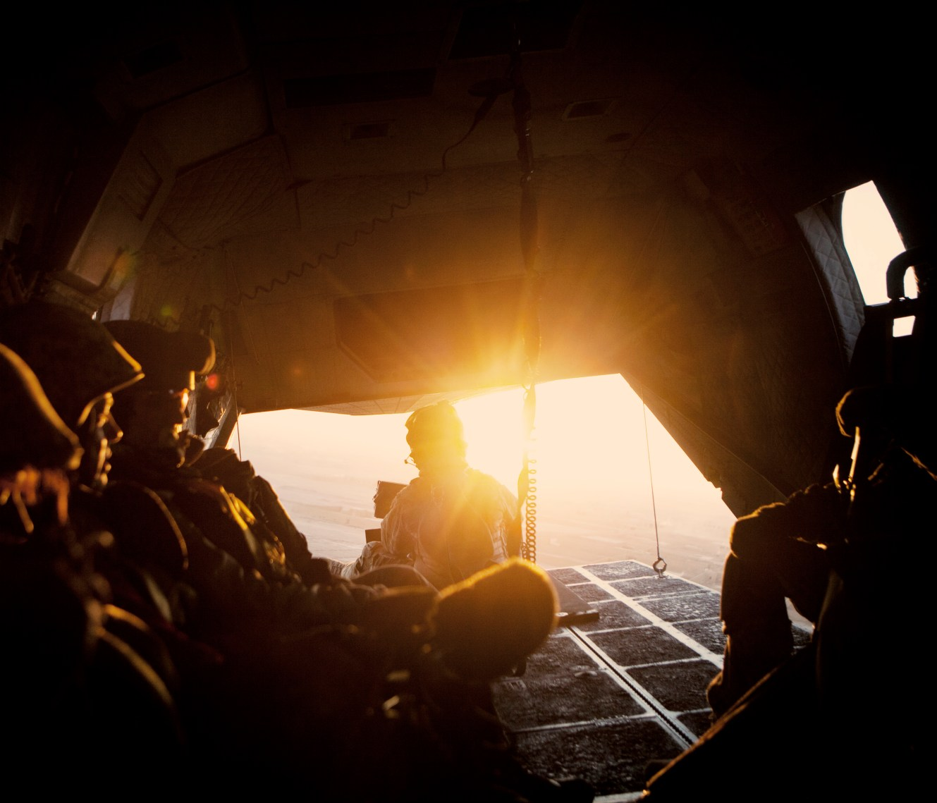 Soldiers sit in the cargo bay of a helicopter as it flies between Lashkar Gah and Camp Bastion. In June 2011, President Obama announced his plan to begin the withdrawal of US troops from Afghanistan, but there is currently no end date for the war in the troubled country. Helmand is the largest province in Afghanistan, and the heart of the war against terror. Commanders on the ground have described the situation as the most brutal conflict the British Army has been involved in since the Korean War. Much of the fighting between NATO and Taliban forces is taking place in this province and Helmand is a true Taliban stronghold. The Helmand River flows through the mainly desert region. With these images I am trying to show a softer side to this troubled area of Afghanistan.