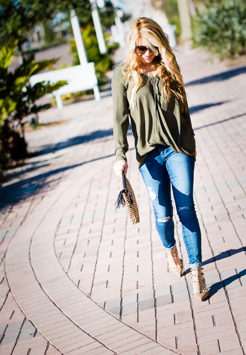 green blouse, valentino, rocketed heels, cheetah clutch, ripped denim, ag jeans