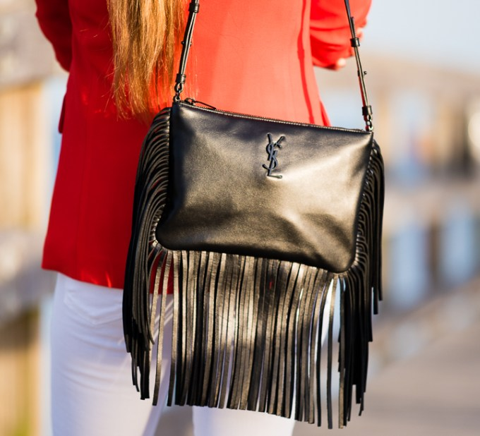 orange blazer, white jeans, fringe handbag, saint laurent handbag