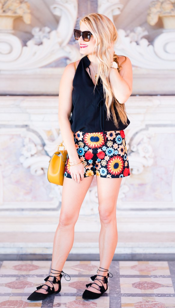 flower shorts, black flats, choe drew bag, black alc top, pointed toe flats, black tank, celine sunglasses, rebecca minkoff bracelets