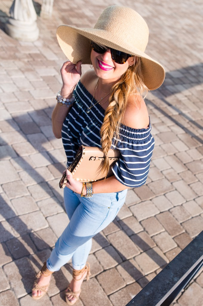 off the shoulder top, light denim, floppy hat, nude heels, celine sunglasses, valentino clutch