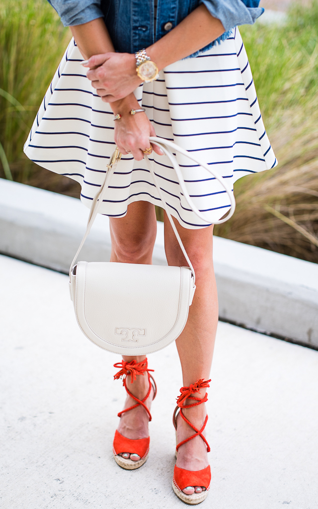 striped dress, lace up wedges, red shoes, jean jacket, denim, tory burch bag, straw fedora, white tory burch bag, serif t