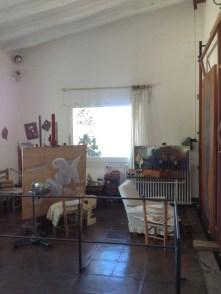 Dali's studio with two original paintings.