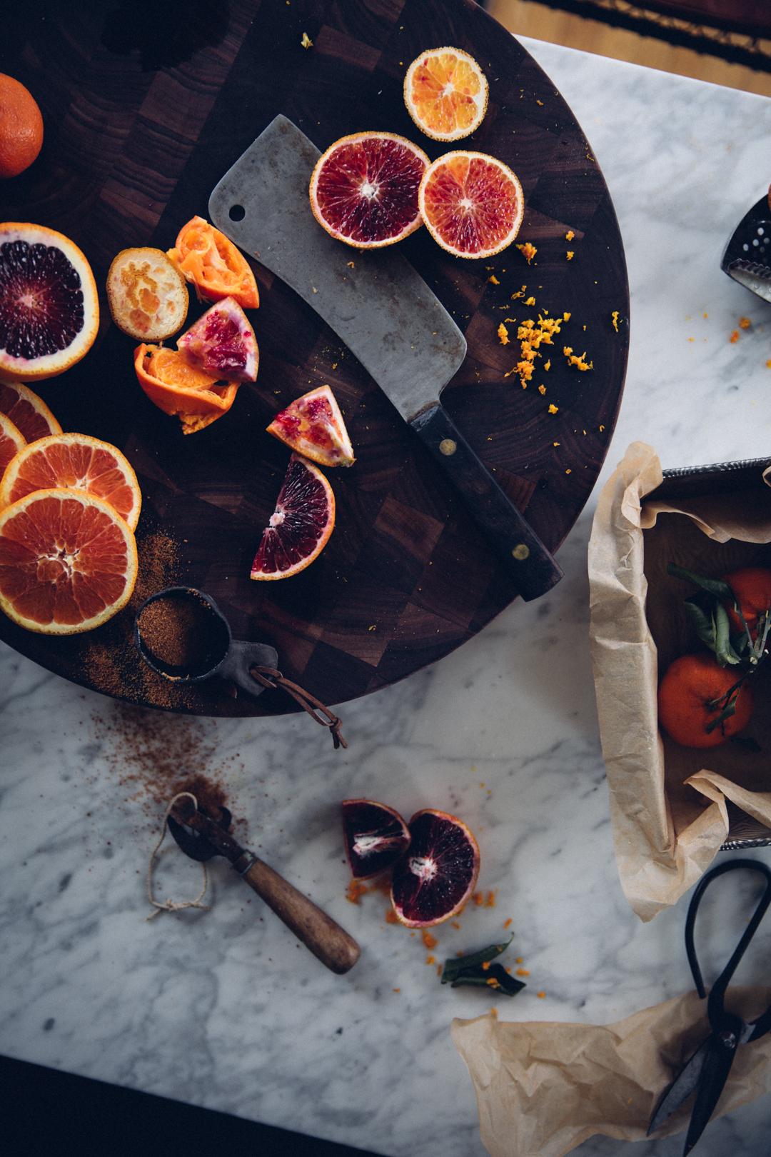 Blood oranges on cutting board.