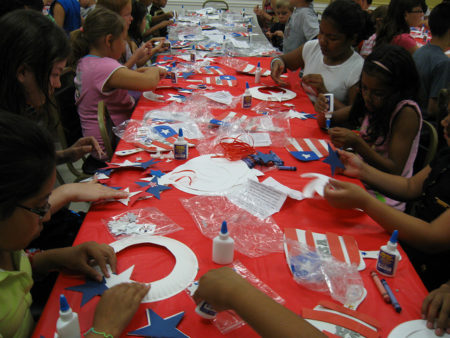 kids making July 4th crafts