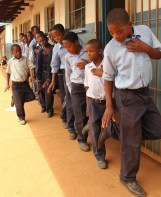 School boys singing about the need to conserve the Rhinos