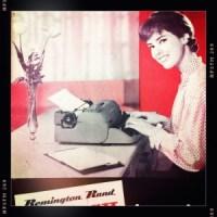 1960's photo of woman at Remington typewriter
