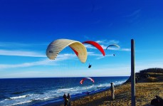 Paragliders brave cool temperatures at White Crest Beach in Wellfleet