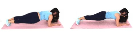 Christina Carlyle doing a hip dip ab exercise at home