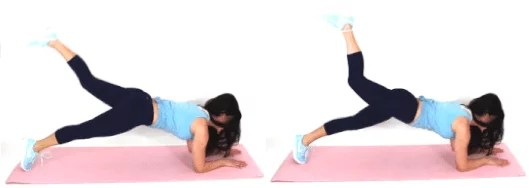 Christina Carlyle doing a marching plank ab exercise at home