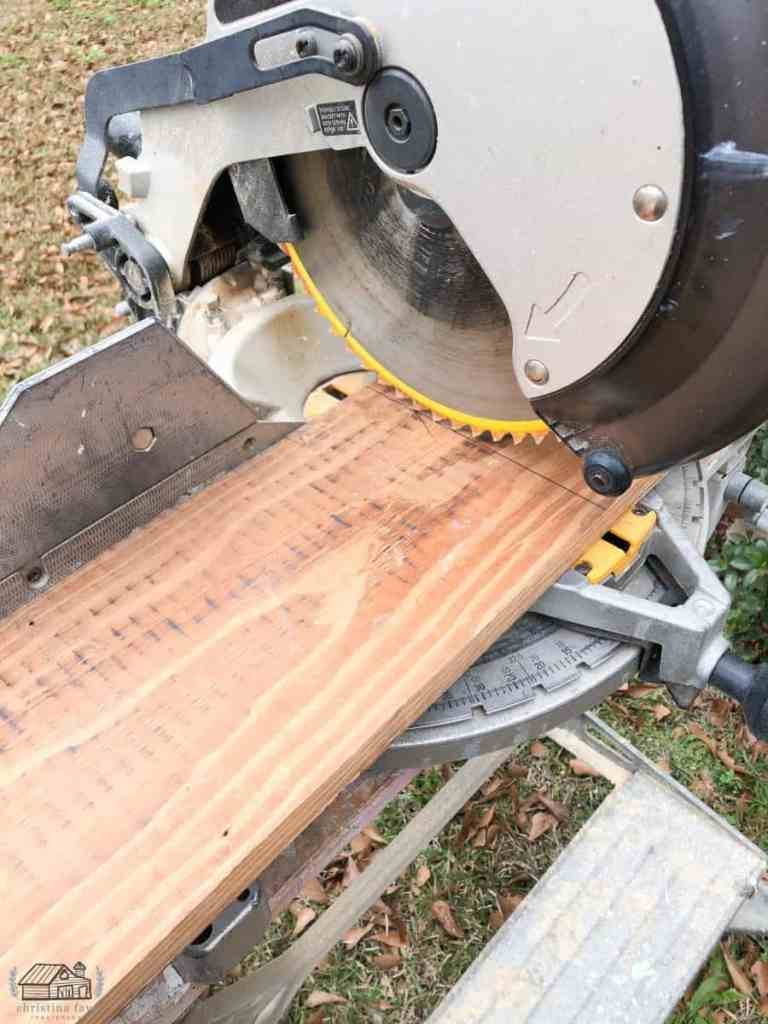 Cutting wood slats to length needed using chop saw.