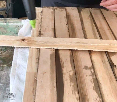 Gluing strip to back of thrift store frame