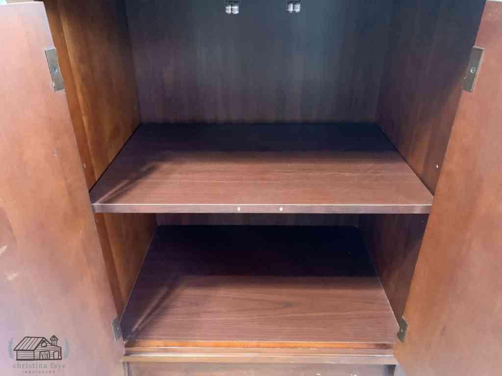 Inside of cabinet showing shelves.