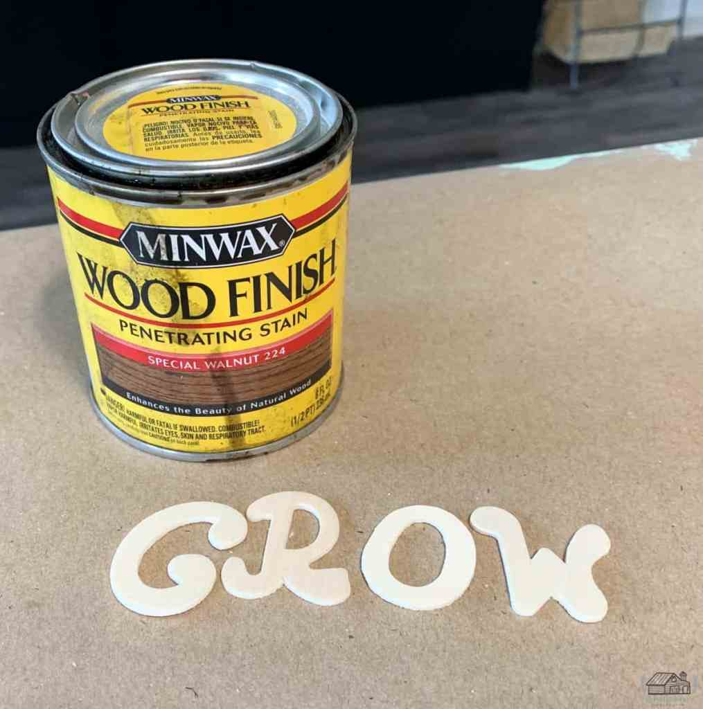 Picture of Minwax Stain Special Walnut and wooden letters