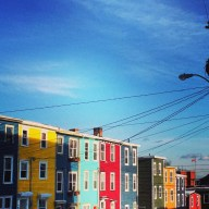 This is perhaps what he is envisioning - Jellybean row in downtown St. John's, NL