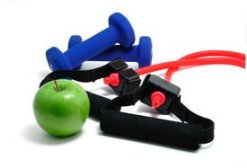 Resistance band, blue weights and green apple isolated on a white background