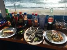 Oysters, fish taco, swordfish taco by the beach