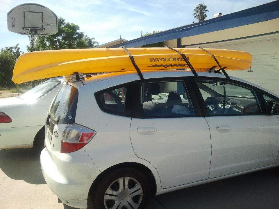 photo of our kayak on the car.
