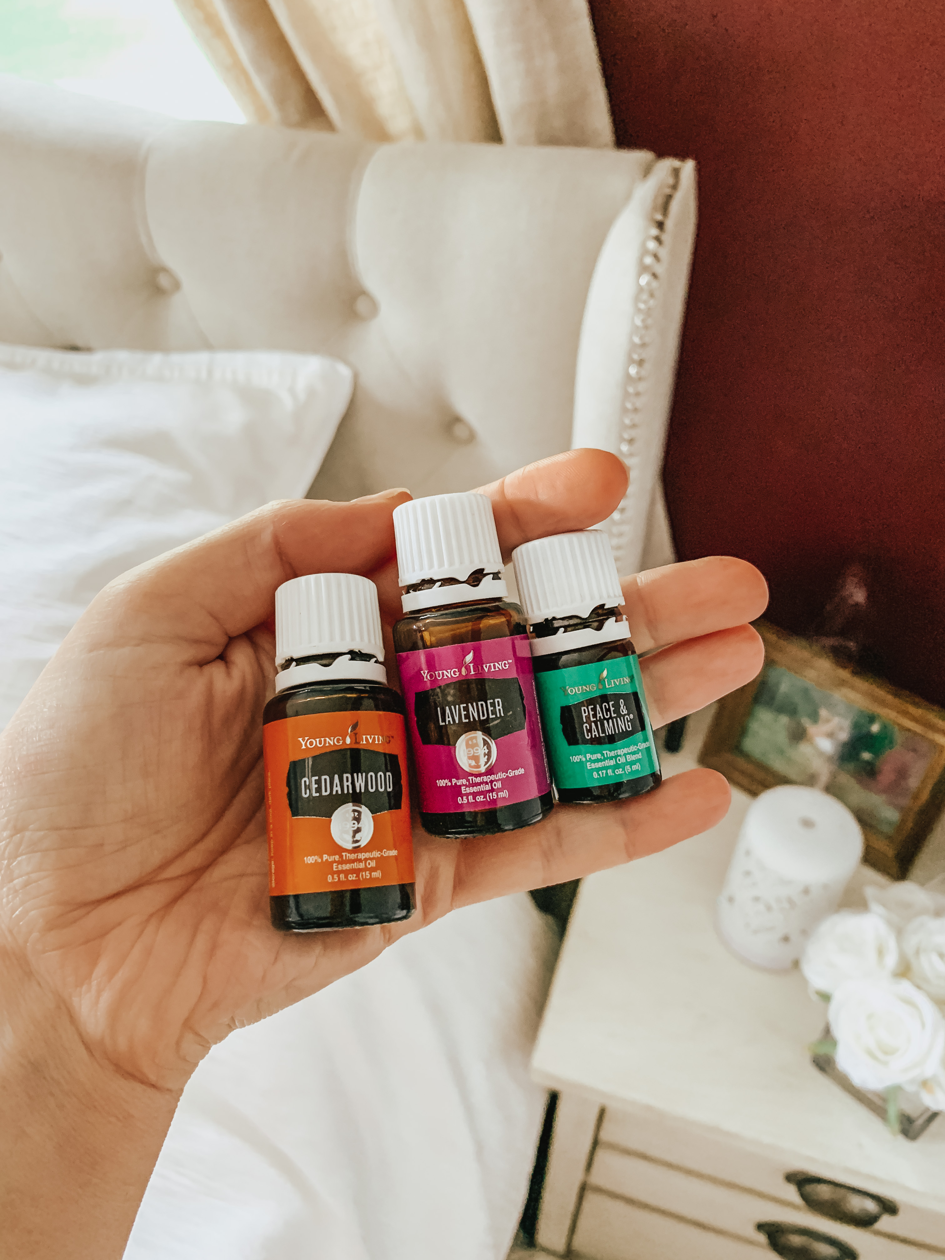 young living oils in hand