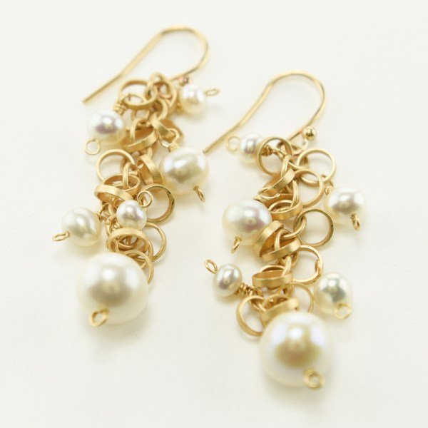 Pearl dangle earrings in matte gold