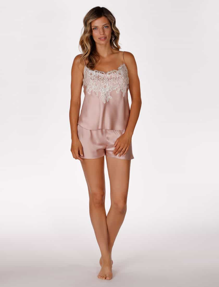 A silk pink cami and tap set with lace is worn by a women