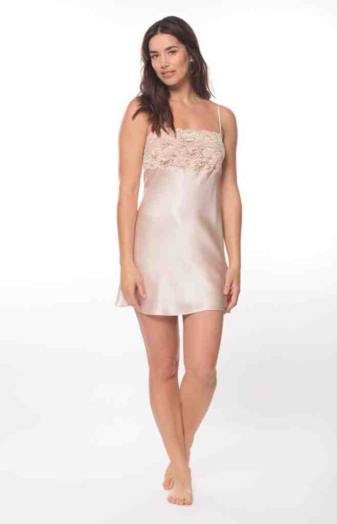 A pink silk chemise with a pink lace bust is worn by a women