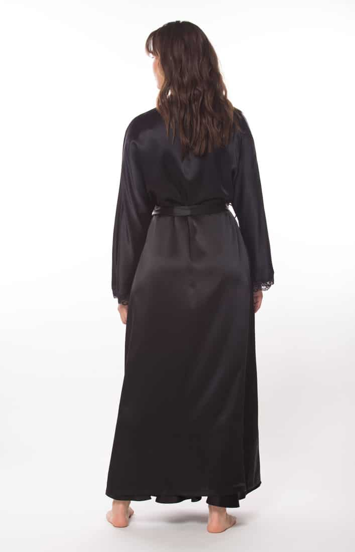 A silk black long robe is worn by a women