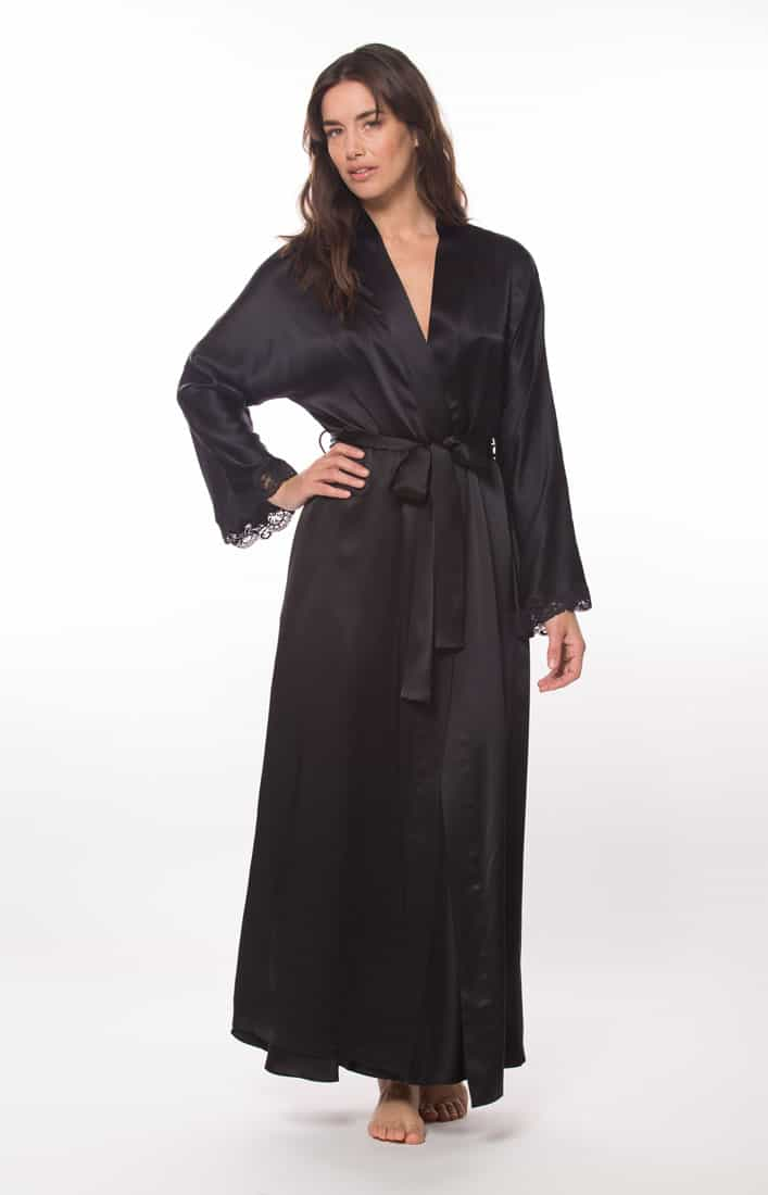 A silk black long robe with black lace is worn by a women