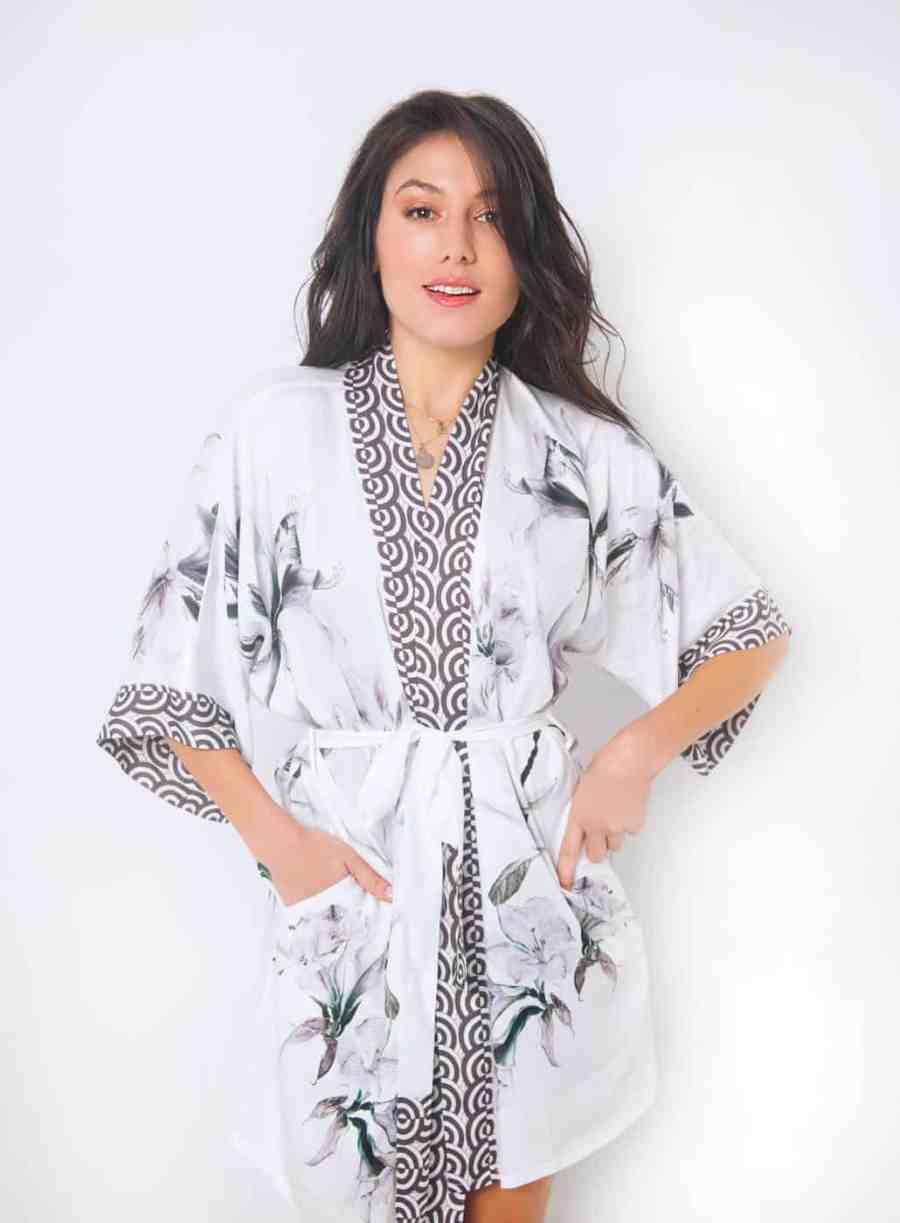 rayon short robe with our floral serentiy print is worn by a women