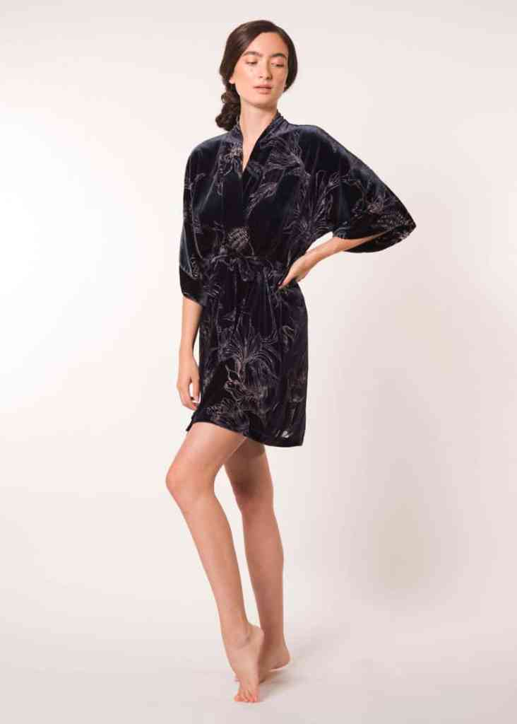 velvet midnight and print short robe is worn by a women