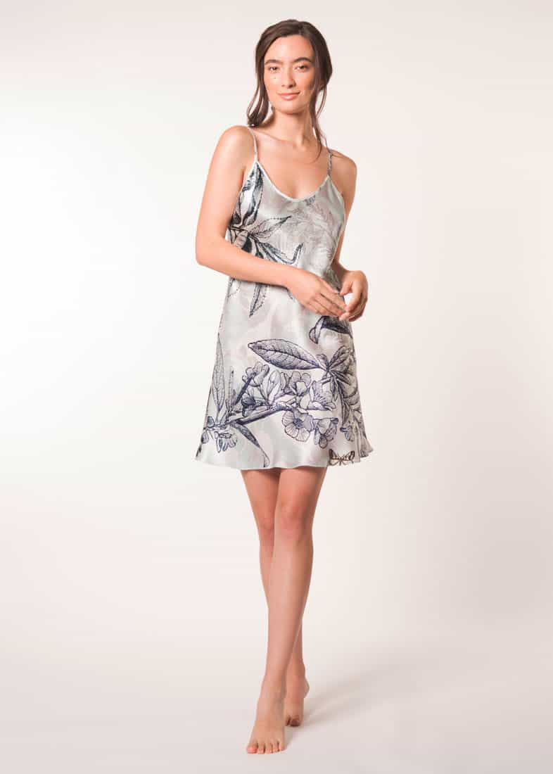 A silk chemise in Christine Lingerie floral botanica print is worn by a women