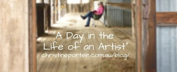 "A photo of Christine sitting in a shearing shed. Over the photo are the words ""A day in the life of an artist"" ChristinePorter.com.au/blog/"