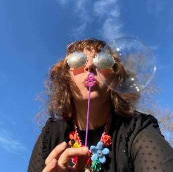 Christine Rai blowing a bubble