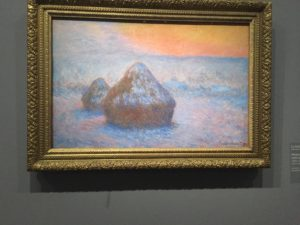 Monet; Haystack in snow at sunset