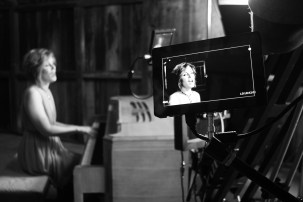 Singer songwriter Christine Rosander singing on set of the Been A Long Time music video.