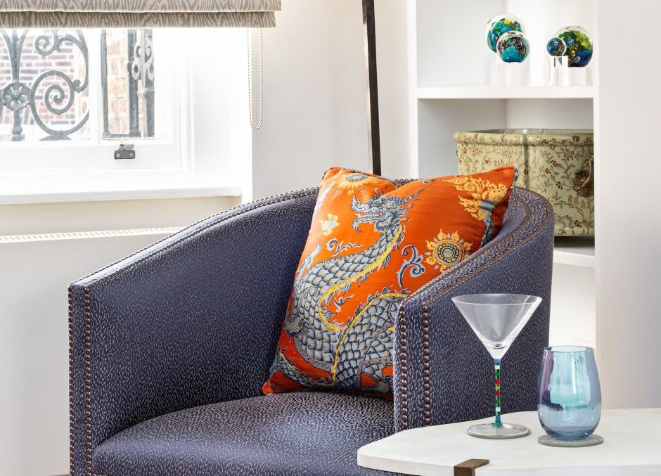 Kensington Townhouse_Family Room_Den_Snug_Purple and Orange colour scheme_Warm colour scheme_Grandmillennial style_Jim Thompson silk panlong fabric in Orange__Tse design studio_Christine Tse Interiors_South Kensington_Kensington_American Expat in London neighbourhood_Interior Designer London Kensington_tv room_lounge_Purple lounge chair_Cowtan and Tout fabric