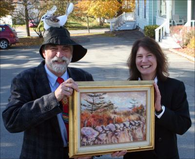 Rev. Bill Gibson wears the seagull-topped sou'wester that will be auctioned off at the 33rd annual Christmas Angels show on Dec. 6 in Windsor, as funding co-ordinator Cathy Cox holds the Garth Vaughan painting that will go to the successful bidder. (GLEN PARKER )