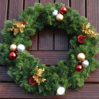 Christmas door wreath with bauble decoration