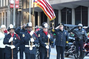 St. Louis Fire Department holding the flag at the 2013 Ameren Missouri Thanksgiving Day Parade.
